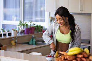 Black Women cutting fruit after IV boost treatment