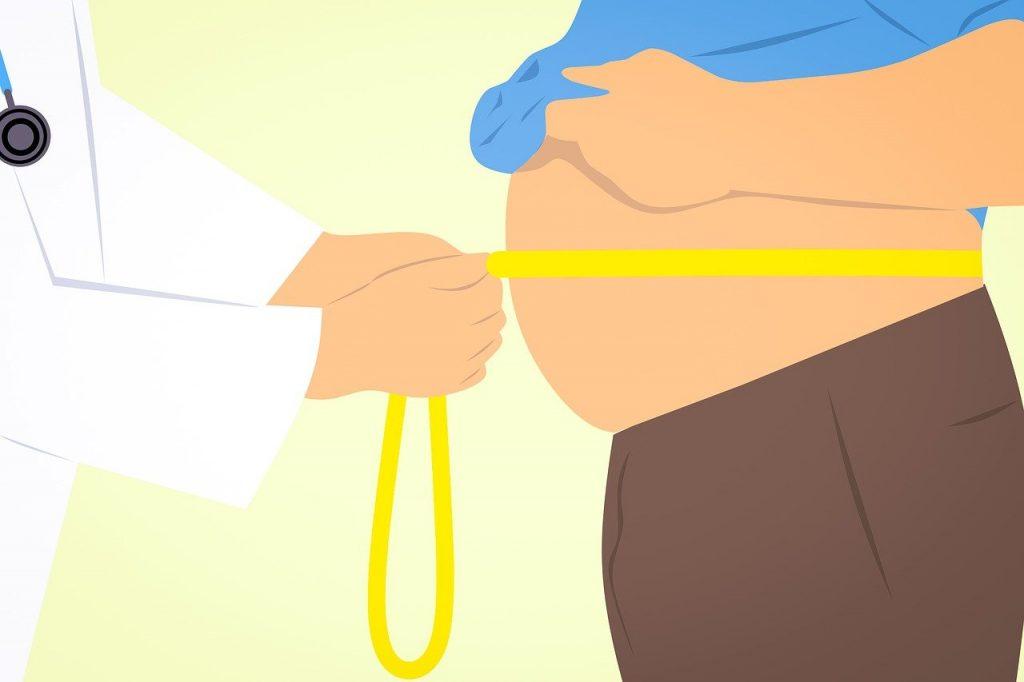 doctor-measuring-fat-liposuction