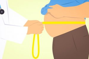 doctor-checking-weight-for-liposuction